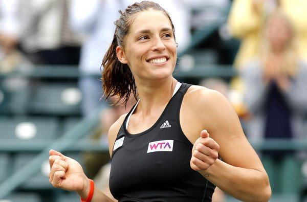 Andrea Petkovic, of Germany, reacts after defeating Jana Cepelova, of Slovakia, in two sets during the Family Circle Cup tennis tournament final in Charleston, S.C., Sunday, April 6, 2014. Petkovic won 7-5, 6-2 to win the championship. (AP Photo/Mic Smith) ** Usable by LA and DC Only **